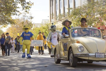 Banana Slug Parade participants walk and drive down Pacific Avenue