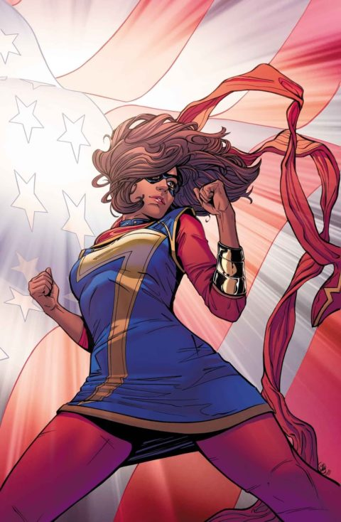 Ms. Marvel stands heroically in front of the American flag