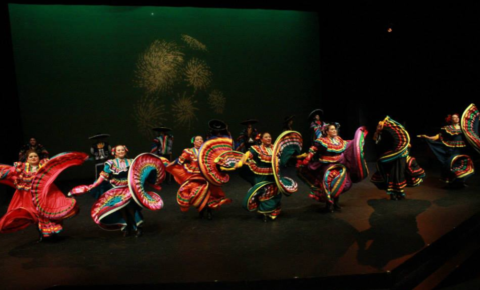Los Mejicas dancers on a stage.