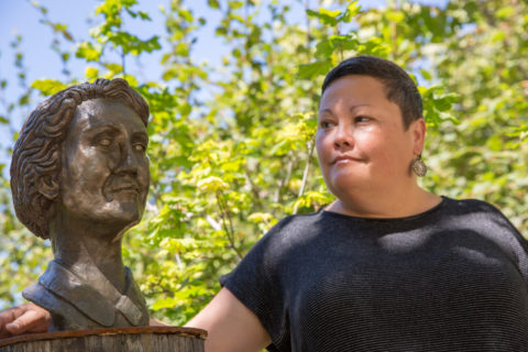 Alumna Rachel Maryam Smith with her bust of Rachel Carson.