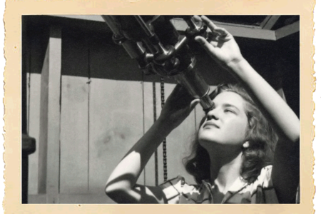 Vera Rubin peering through telescope