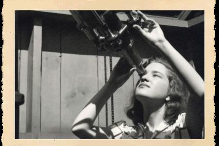 Vera Rubin peering through telescope