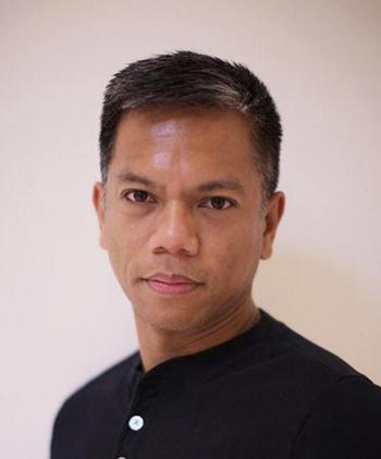 Associate professor of theater arts Gerald Casel
